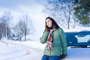 woman_calling_for_help-winter_driving-iStock_000015281121-jean-marie_guyon