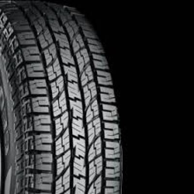 Image of a Yokohama 100/97S  LRC Geolandar A/T G015 OWL tire, which can be found at Active Green + Ross in Toronto, ON
